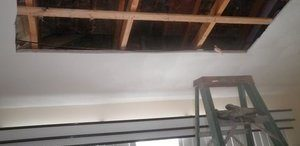 Water Damage Restoration On Ceiling In Progress