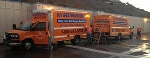 Mold and Water Damage Restoration Vans And Trucks Ready At Headquarters