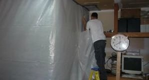 Water Damage Restoration Pro Sealing In Mold With A Vapor Barrier